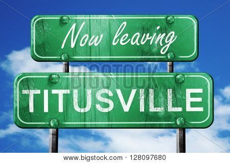 Leaving titusville, green vintage road sign with rough lettering