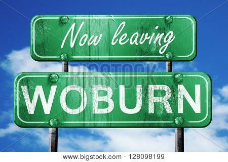 Leaving woburn, green vintage road sign with rough lettering