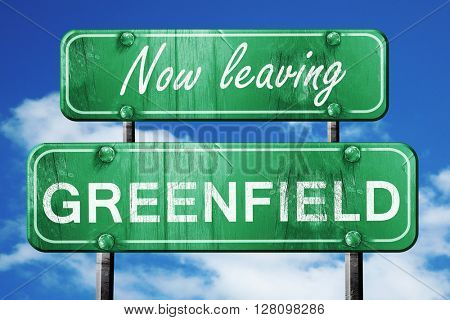 Leaving greenfield, green vintage road sign with rough lettering
