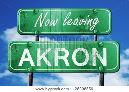 Leaving akron, green vintage road sign with rough lettering