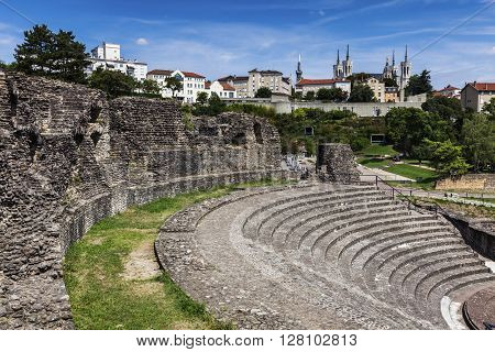 Ruins of Roman Theatre in Lyon. Basilica of Notre-Dame de Fourviere in the background. Lyon Rhone-Alpes France.