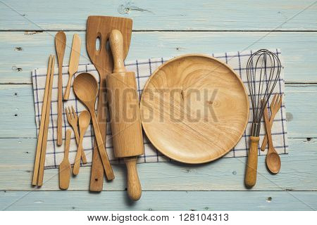 Overhead view of wood utensils on wood board background