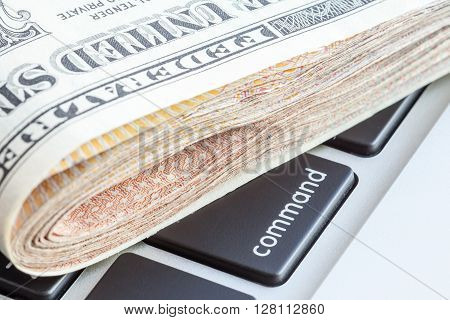 Close-up folded of US dollars banknotes on command sign Business concept.
