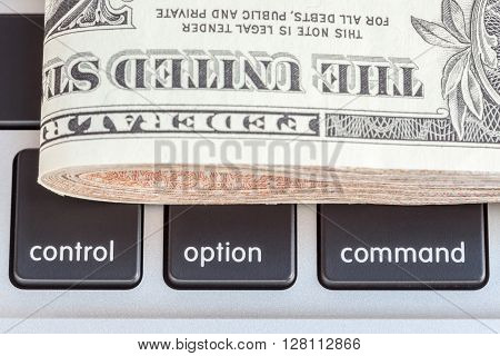 Close-up folded of US dollars banknotes on control option and command sign Business concept.