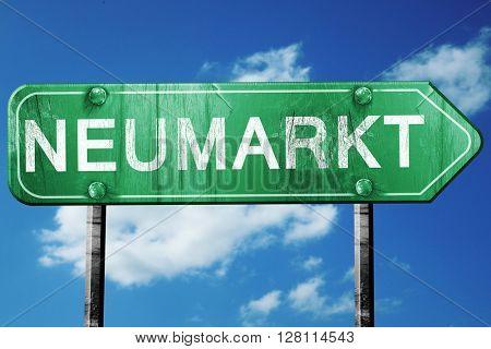 Neumarkt road sign, 3D rendering, vintage green with clouds back