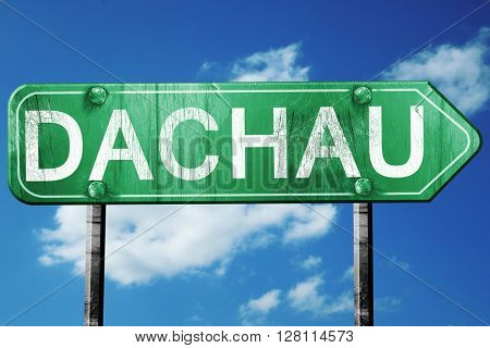 Dachau road sign, 3D rendering, vintage green with clouds backgr