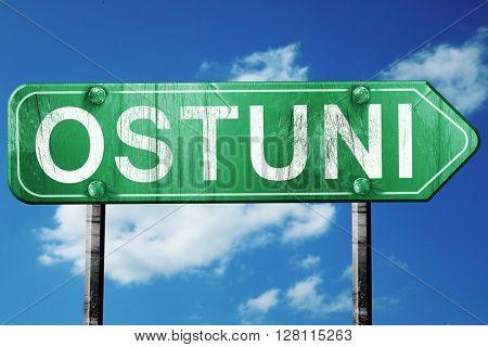 Ostuni road sign, 3D rendering, vintage green with clouds backgr