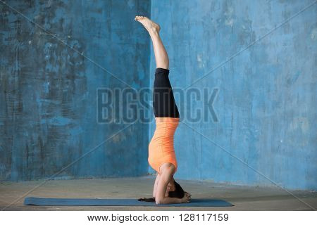 Sporty Beautiful Young Woman Doing Headstand