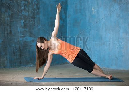 Beautiful Young Woman Doing Side Plank Pose