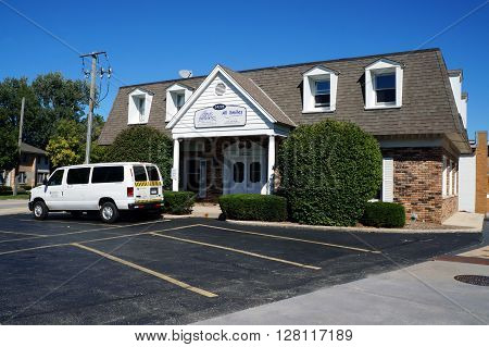 PLAINFIELD, ILLINOIS / UNITED STATES - SEPTEMBER 20, 2015: One may have endodontic work performed at A-Plus Endodontics, and orthodontic work at All Smiles Orthodontics, in downtown Plainfield.