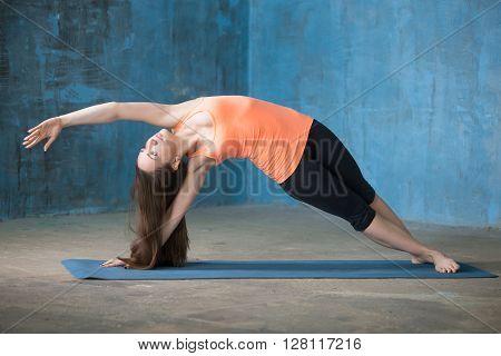 Sporty Beautiful Young Woman Doing Vasisthasana Pose