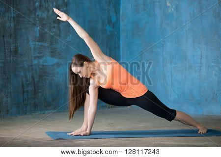 Sporty Beautiful Young Woman Doing Extended Side Angle Pose