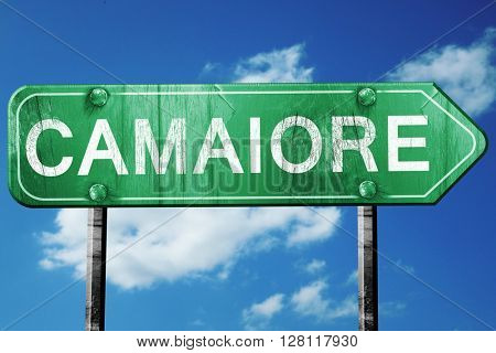 Camaiore road sign, 3D rendering, vintage green with clouds back