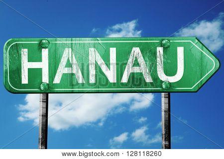 hanau road sign, 3D rendering, vintage green with clouds backgro