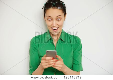 Shocking News! Business And Technology. Close Up Portrait Of Surprised Young Woman In Casual Clothes