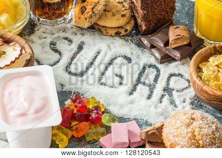 Selection of food high in sugar, written sugar