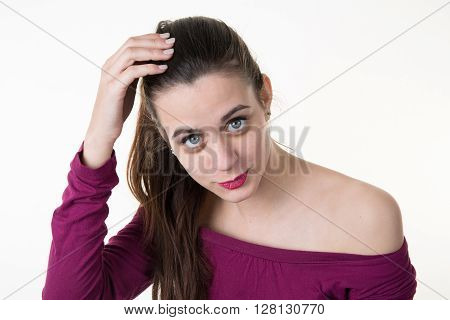 Beautiful Woman Holding Her Hair .looking At Camera.