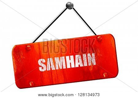 Traditional glowing Samhain Jack-o-Lantern with carved word 'Sam