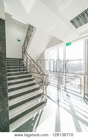 staircase - corridor-story office building. sunny interior