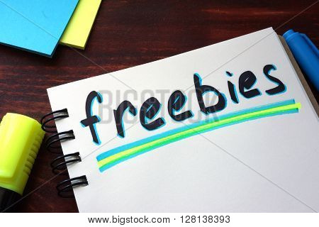 Freebies written on a notepad with marker.