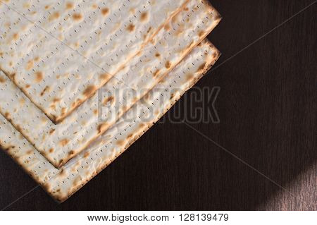Matzo on brown background isolated closeup photo