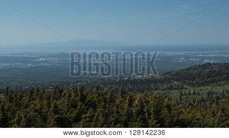 Mount Susitna rises above the city of Anchorage, Alaska