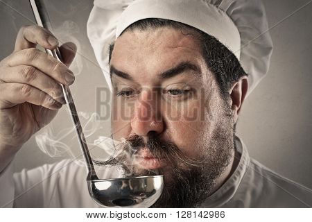 Cook savoring the meal