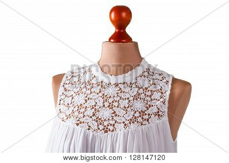 White sleeveless summer top. White top on armless mannequin. Girl's high-quality summer garment. Last size in stock.