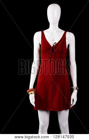 Short dress with keyhole neckline. Mannequin wearing short red dress. Lady's brand new evening apparel. Attractive clothing on sale.