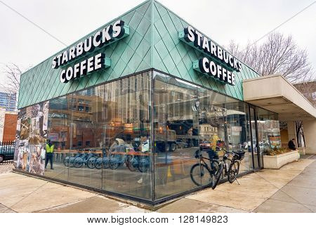 CHICAGO, IL - MARCH 24, 2016: exterior of Starbucks Cafe. Starbucks Corporation is an American global coffee company and coffeehouse chain based in Seattle, Washington