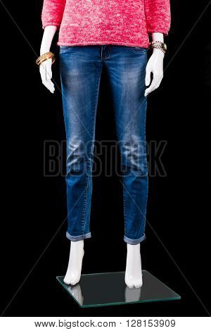 Woman's blue skinny fit jeans. Mannequin wearing blue skinny jeans. Quality denim pants on display. Best prices in fashion boutique.
