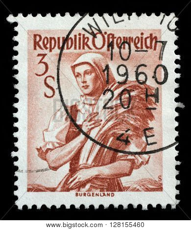ZAGREB, CROATIA - SEPTEMBER 13: A stamp printed in Austria shows image woman in national Austrian costumes, Burgenland, series, circa 1949, on September 18, 2014, Zagreb, Croatia