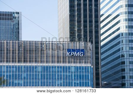 LONDON, UK - MAY 1, 2016: Detail shot of Canary Wharf KPMG skyscraper against blue sky. Canary Wharf is London's second financial district.