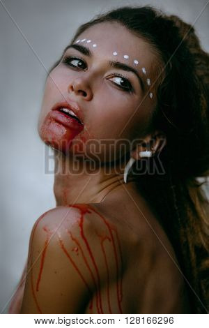 Photos of wild woman showing blood and gore dripping from the mouth
