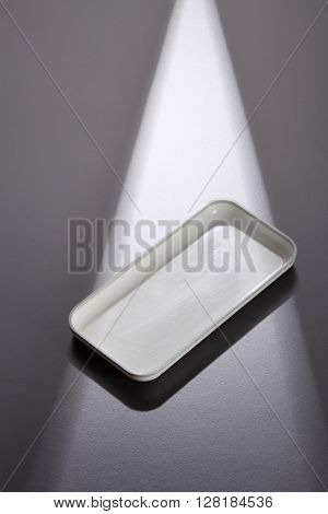 empty receipt tray on the gray background