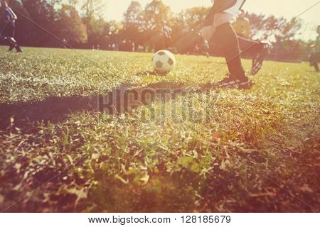 Blurred motion of a childrens soccer game