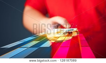 Man holding smartphone with abstract futuristic lines