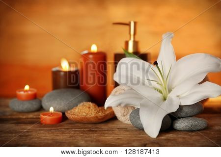 Beautiful spa composition on wooden wall background