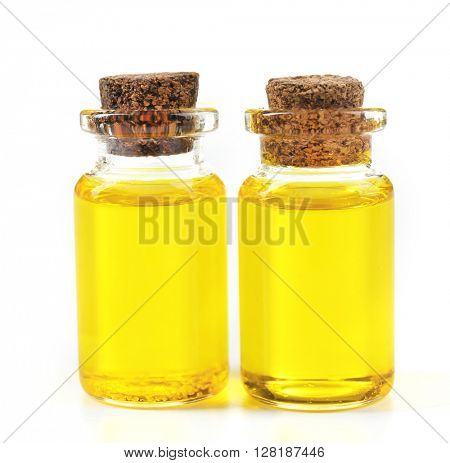 Bottles of tea oil, isolated on white