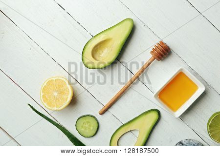 Still life with avocado on wooden table, top view