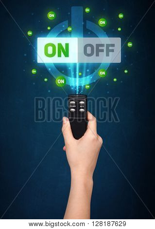 Hand holding a remote control, on-off signal coming out of it
