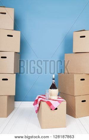 Toast on removal house with boxes and wine
