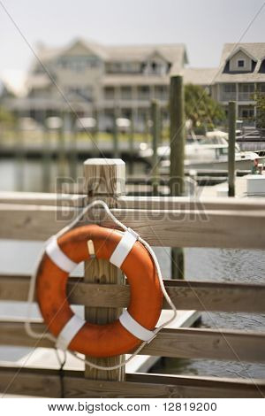 Life preserver hanging on dock on Bald Head Island, North Carolina.