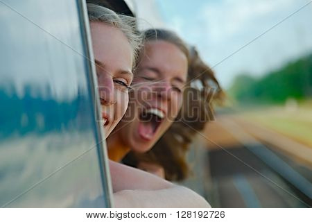 Two girls enjoying train travel