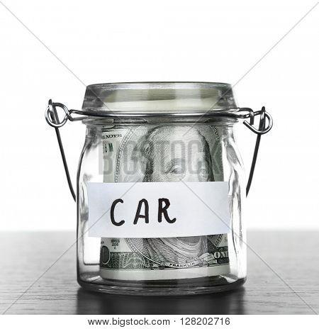 Jar for savings full of banknotes poster