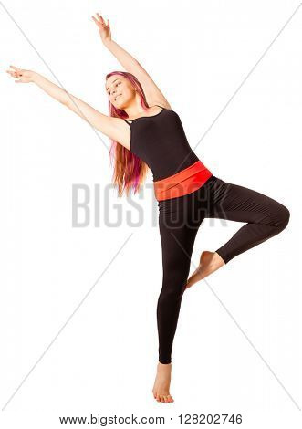 Young dancing woman on white background