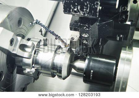 metal working. cutting tool pefroming turning operation at cnc machine