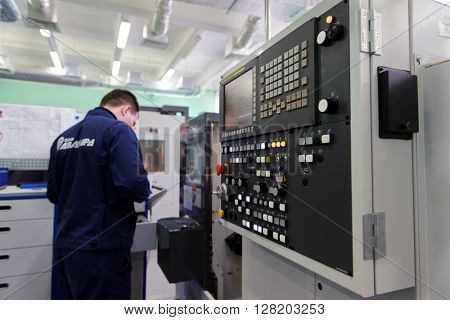 ST. PETERSBURG, RUSSIA - APRIL 18, 2016: Man working in the Center of Fine Mechanics at JSC