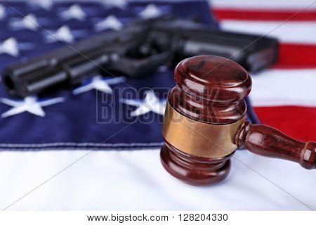 Gavel with gun on background of USA flag