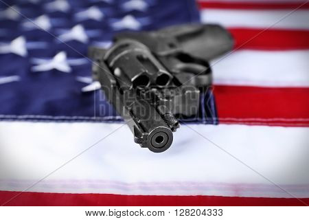 Gun on background of USA flag